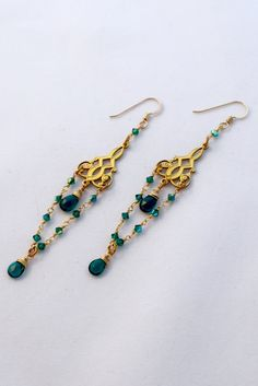 A personal favorite from my Etsy shop https://www.etsy.com/listing/476891463/emerald-green-chandelier-earrings-lush