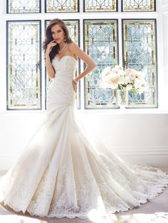 Sophia Tolli - Fit and flare wedding dress with chapel train, with an air of innocence and unexpected sophistication, Muriel will delight on your wedding day. Final Sale