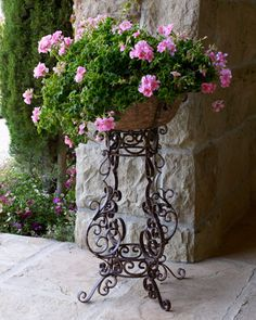 Iron Scroll Planter at Horchow.