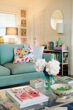 colorful couch, floral pillows, cozy space