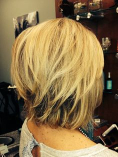 Edgy blonde bob . By Debi S