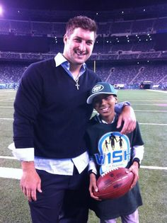 Tim Tebow with Blake Herndon (October 8, 2012)