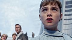 "Raffey Cassidy said if she could take away one trait from her character, she would choose... ""Optimism is what I wanna choose from Athena. She is wise, intelligent. I want to emulate her in real life this way."" Close up of Athena (Raffey Cassidy) watching young Frank Walker arrive in Tomorrowland, with Nix (Hugh Laurie) in the background. Disney's Tomorrowland."