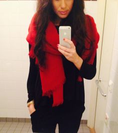 Bright red scarf, all black