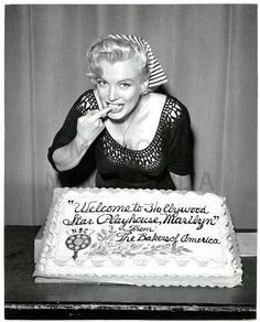 Marilyn Monroe tasting a cake given to her by the sponsor Bakers of America, during her radio debut on the Hollywood Star Playhouse for NBC radio. Photo by Herb Ball, August 1952.