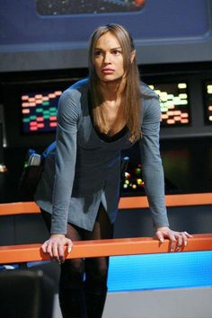 T'Pol wearing old uniform.  In bridge commandar of first enterprise. At least for us.