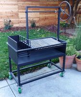 The Ash is an Argentine Grill with Side Brasero and Wheel plus cart