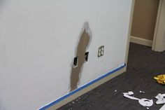 80's Party Room - fixing the walls...and look at the awful carpet!