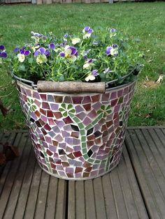 using an old bucket, as a flower pot