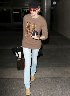 DK in airport chic! Love the Tiger sweater!