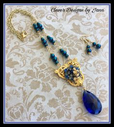 Chandelier Necklace Set .. A beautiful blue chandelier crystal dangles under a Russian Gold Component .. a vintage recycled blue jewelry piece is attached to the component, Gold Plated Chain, blue glass beads complete this beautiful set .. FOR SALE .. $40.00
