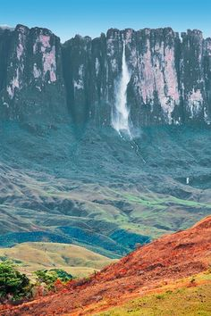 Canaima National Park, Venezuela - look at the waterfall in the background! Venezuela Beaches, Jardim Natural, Places To Travel, Places To See, Places Around The World, Around The Worlds, Wonderful Places, Beautiful Places, South America