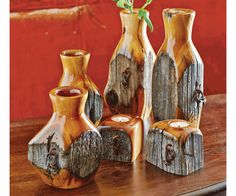 Talk to your hubby! Bet he can mimic this! Reclaimed Fence Post Vases & Candle Holders