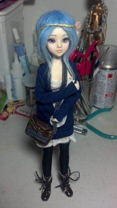 My obitsu, J doll hybrid. 25cm medium soft bust obitsu and robson st J doll head.    New eyes, face up, and wig.