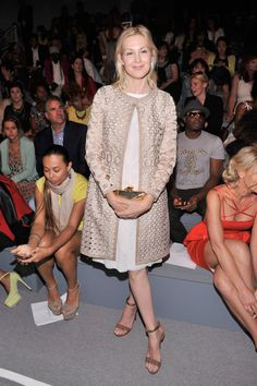 : Kelly Rutherford was prim and proper in a neutral ensemble, including a cool cutout coat, at Vivienne Tam.