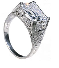 Absolutely GORGEOUS east-west Emerald Cut orientation on this incredible vintage ring!
