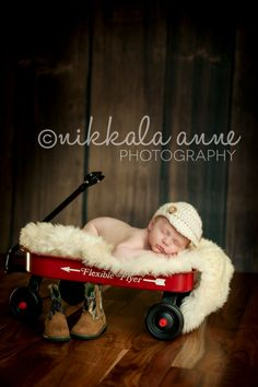 Newborn boy photo session in wagon with boots or without the boots.
