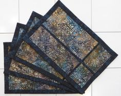 Quilted batik set of four placemats dark by Quiltsbysuewaldrep