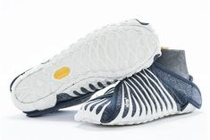 Vibram Furoshiki Japanese Wrapping Shoes | Vibram's Furoshiki shoes wrap around the foot, inspired by the Japanese concept of Furoshiki, or wrapping objects for transport, and are ultra-comfy. #refinery29 http://www.refinery29.com/2015/08/92977/vibram-furoshiki-wrapping-shoe