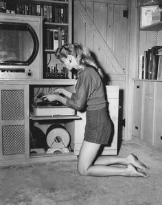 Irish McCalla listens to records. (Best known as the title star of the 1950s television series Sheena, Queen of the Jungle.)