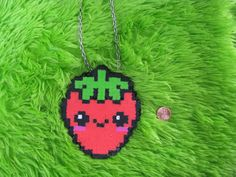 its a little strawberry necklace =3