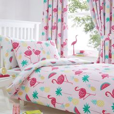 From bluezoo's fantastic range of bedding, this bedding set will add a touch of colour to a little one's bedroom. In a pretty pink hue, it features a flamingo print adorned with palm trees, melons and pineapples for a tropical-inspired finish.