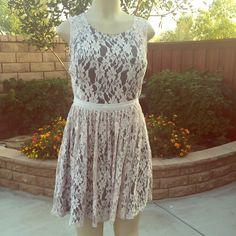 Gorgeous lace dress Beautiful lace dress with back zipper . 70% cotton 30% nylon . Lining 100% polyester . Measurements lying flat . 🔹Large - Bust :17.5 waist : 14 length : 32🔹 Medium  - Bust :16.5 waist : 13 length : 32 Dresses Midi
