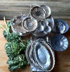 silver, pewter, chrome, and mirror trays and stands,  Nimble Well chicago vintage rentals