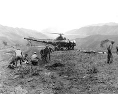 U.S. Marines wounded at Kari San Mountain are evacuated via helicopter and flown to hospital in near areas for treatment.  Navy Corpsmen prepare three wounded Marines for evacuation.  May 23, 1951.  N.H. McMasters.  (Navy) NARA FILE #  080-G-429571 WAR & CONFLICT BOOK #:  1453   Cleared for public release. This image is generally considered in the public domain - Not for commercial use.  U.S. Army Korea - Installation Management Command