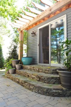 LOVE this back porch/steps/patio. love the materials and shape of the steps (maybe limestone? could my father-in-law do this?) love the arbor, love the brick patio. would want french doors instead of a slider. Patio Pergola, Backyard Patio, Backyard Landscaping, Pergola Kits, Pergola Ideas, Landscaping Ideas, Patio Bar, Cheap Pergola, Patio Steps