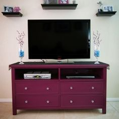 Take an old dresser, take out the top drawers, & BOOM! You've got yourself a TV stand - cute color