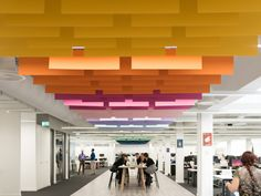 Multi-coloured acoustic baffles, MOO Offices – London, Peldon Rose has recently collaborated with Trifle Creative to design the new offices of on-demand printing company