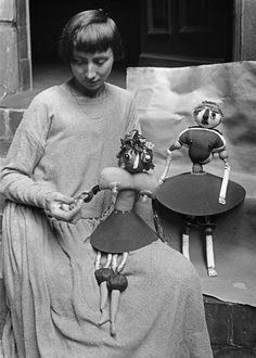 Hanna Höch with two Dada dolls meant to represent her daughters Pax and Botta, c. 1920.  photo by Willy Roemer