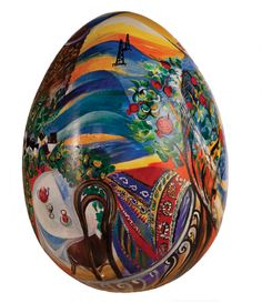 'My Baku' by Asmar Narimanbekova.  The Egg is an ancient symbol of fertility. Pomegranate has a special meaning in Azerbaijan culture, representing fertility and flowing with the energy of life. The image of the sea and sand of the Caspian coast; a flowering tree; magical colours of a traditional carpet representing the sun caressed Apsheron Peninsula are all encased on the surface of the egg.