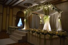 Lighting is so important for your altarpiece! Draping and florals galore!