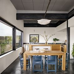 Steel beams and window frames. Live / Work Space by Rick & Cindy Black Architects. Photo by Casey Dunn.