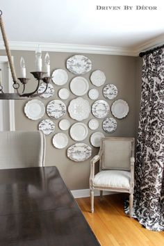 Hanging Plates to Create a Decorative Plate Wall, or we could find different sized round picture frames and do this with family PICs. Sort of like the photo wall we had on Kitty Hawk.
