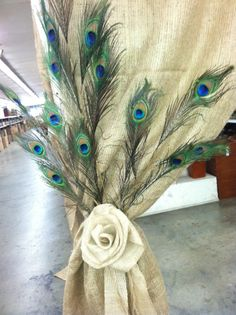 Burlap and Peacock feather...wow! Don't forget personalized napkins to match! Purple,teal, and silver are perfect choices for a peacock wedding!! www.napkinspersonalized.com                                                                                                                                                      More