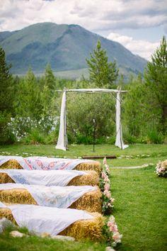 Glacier Park Montana Weddings | Mountain wedding ceremony with straw-bale seating | Photo by @Cluney Photo
