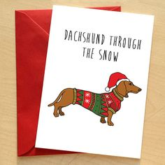 Dachshund through the snow - by Catherine Went, 120x170mm Greetings Card. Message inside reads: Christmas Wishes  Printed in the UK on thick 300gsm