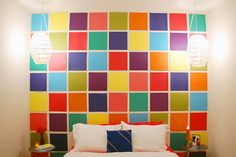 this is just scrapbook paper squares hung on the wall. Kids room idea.Tutorial is here!