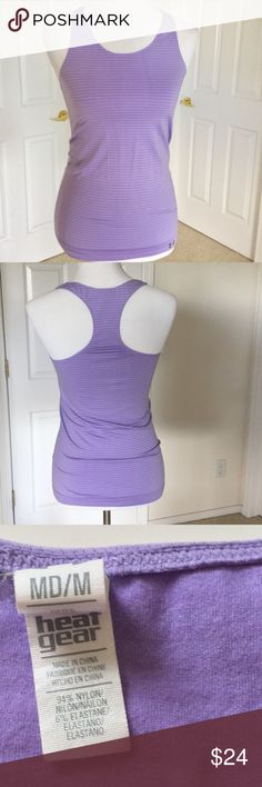 🆕 Listing Under Armour Racer Back Tank Heat Gear racer back tank. Light purple with darker purple stripes. Stretchy. Excellent used condition. Worn once or twice. Machine wash. Workout. Exercise. Gym. Running. Biking. Hiking Walking 🎀Bundle discount  ⭐️5 star rated Suggested User 🚭Smoke free home 🚫No trades please  😍 Thank you for shopping with me. Please ask all questions before purchase Under Armour Tops Tank Tops