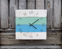 This beach themed clock, is made from pallet like wood, painted in colors of white, water blue and a sea foam green. Black numbers and black clock hands finish this coastal clock. * Clock measures app