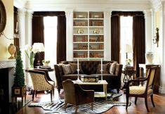 Brown velvet regency style living room. Velvet drapery and sofa.