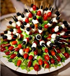 Great kabob presentation. Tomatoes, olives, mozzarella and cucumber skewers inserted into a half a head of lettuce.
