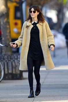 """We love, love, [i]love[/i] this chic and cosy look from [link url=""""http://www.glamourmagazine.co.uFdaistyk/celebrity/biographies/Alexa-Chung""""]Alexa Chung[/link]; so follow her sartorial lead by investing in a Teddy Bear shearling coat, simple black mini dress with lace collar and some super boots and Tortoise-shell sunglasses. Et voilà, you are (pretty much) Alexa Chung."""