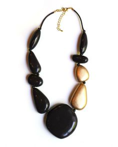 Sylca Designs Handcrafted Brown and Gold Statement Necklace This wooden brown and gold necklace is made of multi- shape brown wooden beads and accented with two
