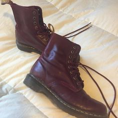 Cherry Red Dr. Martens These Dr. Marten cherry red boots are a classic. These boots pair well with just about any pair of jeans and a comfy tee. Just a bit of wear which is pictured. Dr. Martens Shoes Combat & Moto Boots