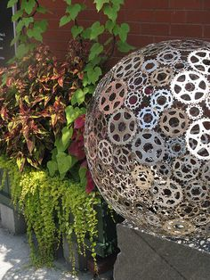 My love of large concrete garden spheres translated into my father's love  of biking.   Gear Sphere by James Irving   Sculptcycle 2009