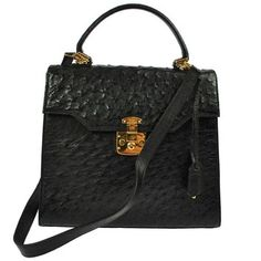 Gucci Ostrich Hand Leather Vintage Italy Ghw W/strap Black Tote Bag. Get one of the hottest styles of the season! The Gucci Ostrich Hand Leather Vintage Italy Ghw W/strap Black Tote Bag is a top 10 member favorite on Tradesy. Save on yours before they're sold out!